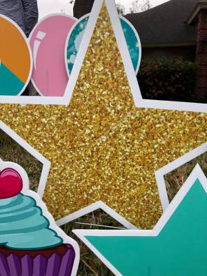 Stars, cupcakes and balloon imagery is popular in front yard designs.