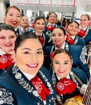 Mariachi Margaritas are all smiles after performing in front of a huge crowd at AT&T Stadium in Arlington. (Courtesy)
