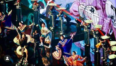 The Mariachi Margaritas play behind Canelo Alvarez and singer Pepe Aguilar at AT&T Stadium.