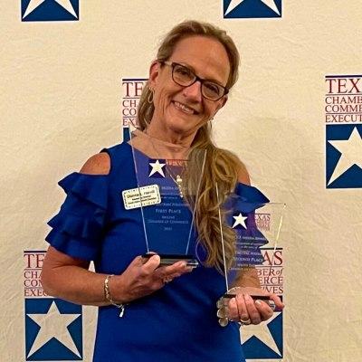 Marketing Director Dianna Harvill receives media awards on behalf of the SPI Chamber of Commerce. (photo SPI Chamber)