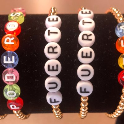 Bracelets with pro-Latina messages of confidence and strength.