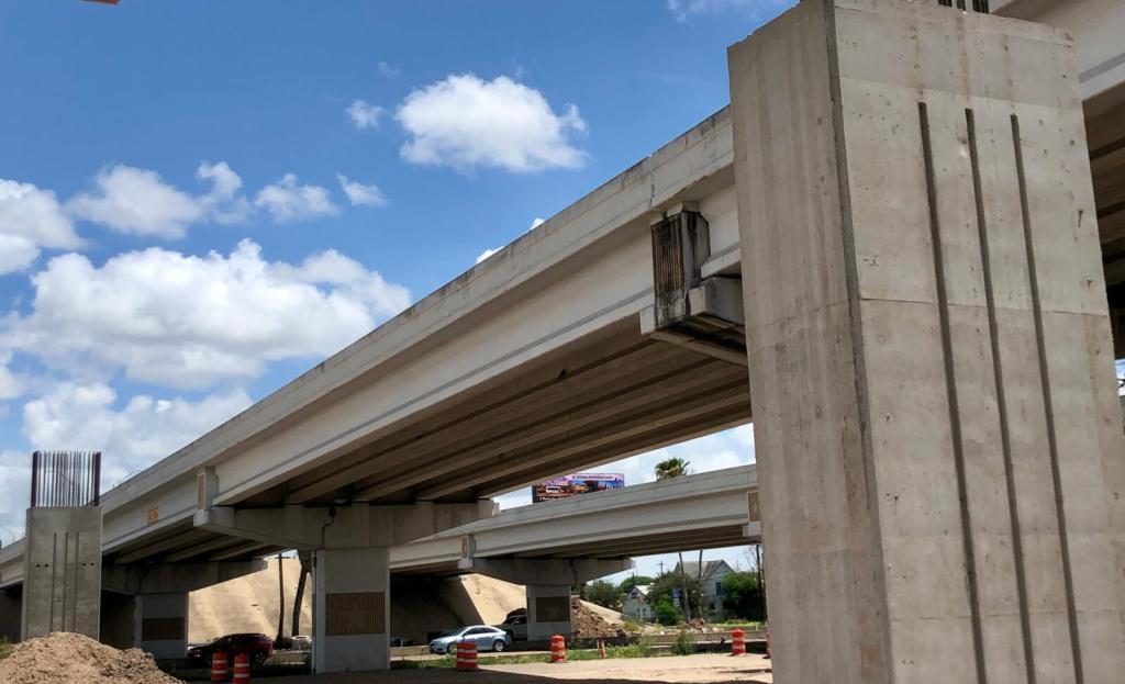 Concrete pillars mark where a new span of the Pharr Interchange begins near FM 495.