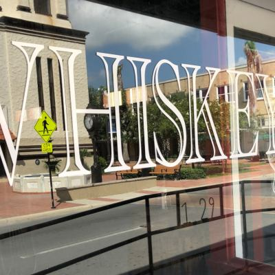 The 1929 Whiskey Tavern, with Market Square in the window reflection, is one of many Brownsville businesses to receive local grants to help open and develop downtown properties.