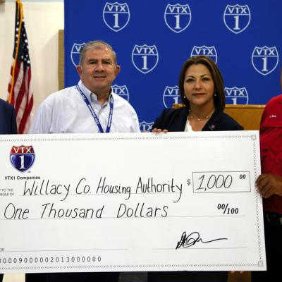 VTX1 provides a $1,000 sponsorship check to the Willacy County Housing Authority to help cover costs for a new playground. In attendance were Dr. Adalberto Garza, VTX1 board member; Patrick McDonnell, VTX1 COO; Dolly Villarreal, VTX1 board president; and Jaime Serna, the housing authority's executive director.