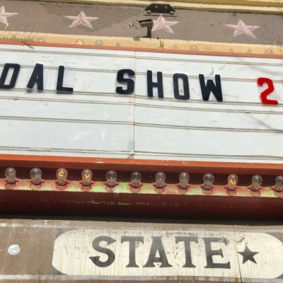 The State's old marquee announces Bridal Show 2021 in Mercedes.