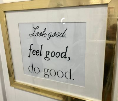 Inspirational sayings and quotes hang up throughout the Golden Girl Boutique.