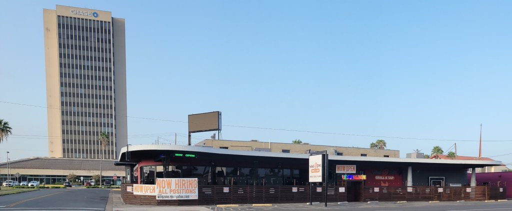 The iconic Chase Bank tower serves as a backdrop for Wing Zone Grill & Tap on Business 83 in McAllen.