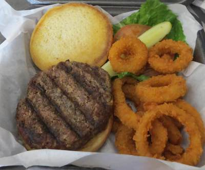 Curbside and carry-out are also available at Wing Zone in McAllen. Angus burgers are made to order and crispy onion rings are one of the restaurant's popular sides.