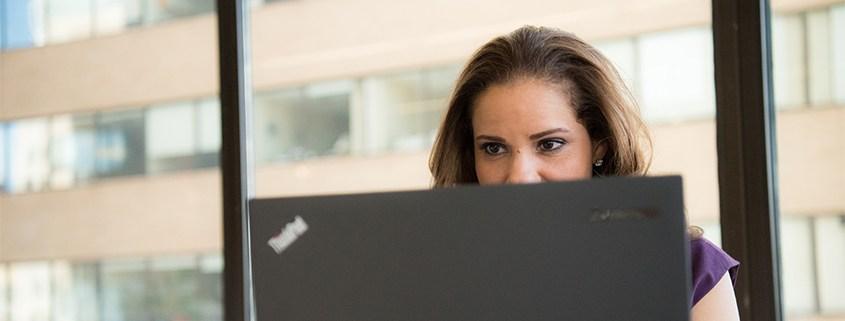 Woman looking at computer at work