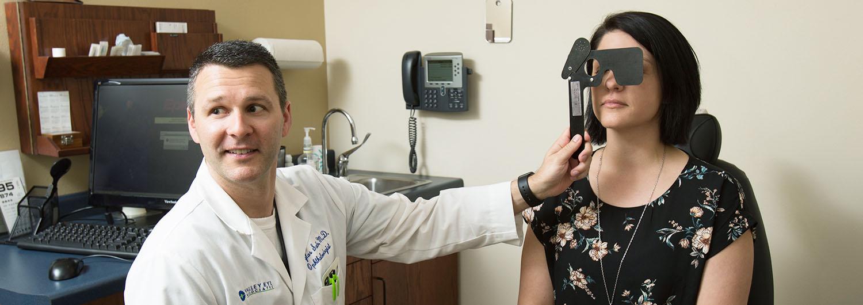 Dr. Salm examining patient