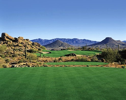 Troon North Golf Club stands as a hallmark of the Scottsdale desert golf experience with two 18-hole courses stretching through the natural ravines and foothills in the shadows of Pinnacle Peak. Giant granite boulders lie strewn across the rugged landscape of Arizona's Sonoran Desert, where Troon North Golf Club combines iconic golf with the visual sensation of desert landscape, providing a standard unmatched in the American Southwest.