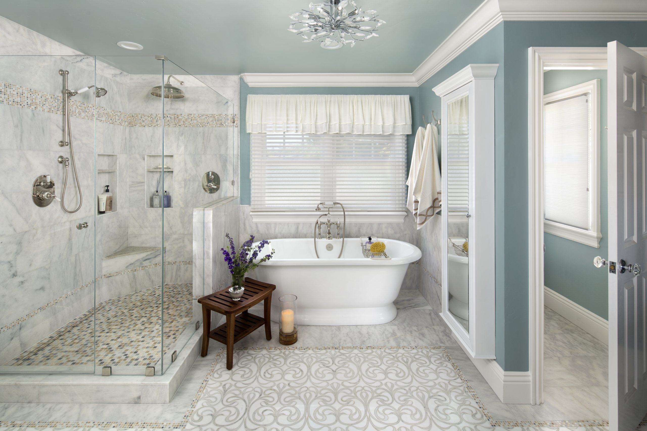 A traditional style bathroom with porcelain tub and glass shower.