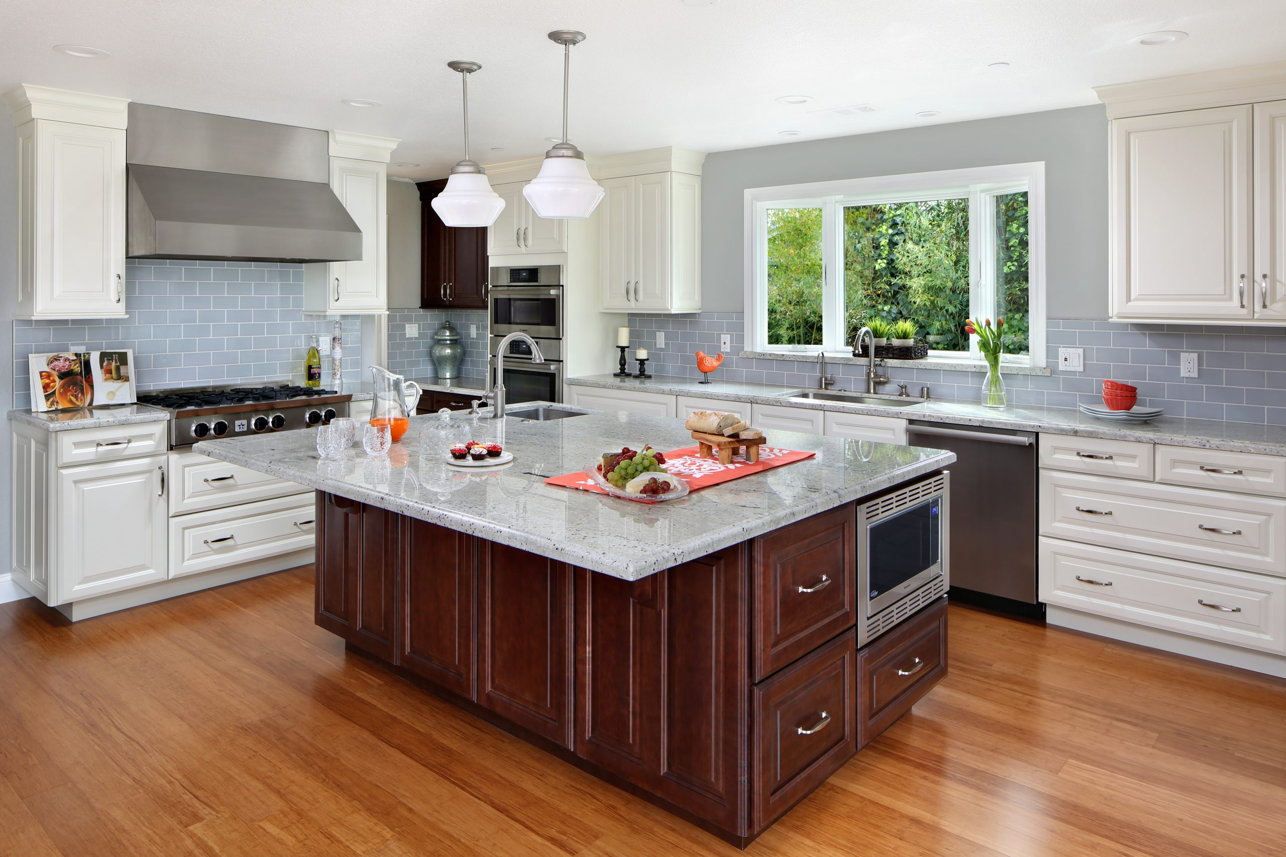 A kitchen with a large center island with granite counter tops.