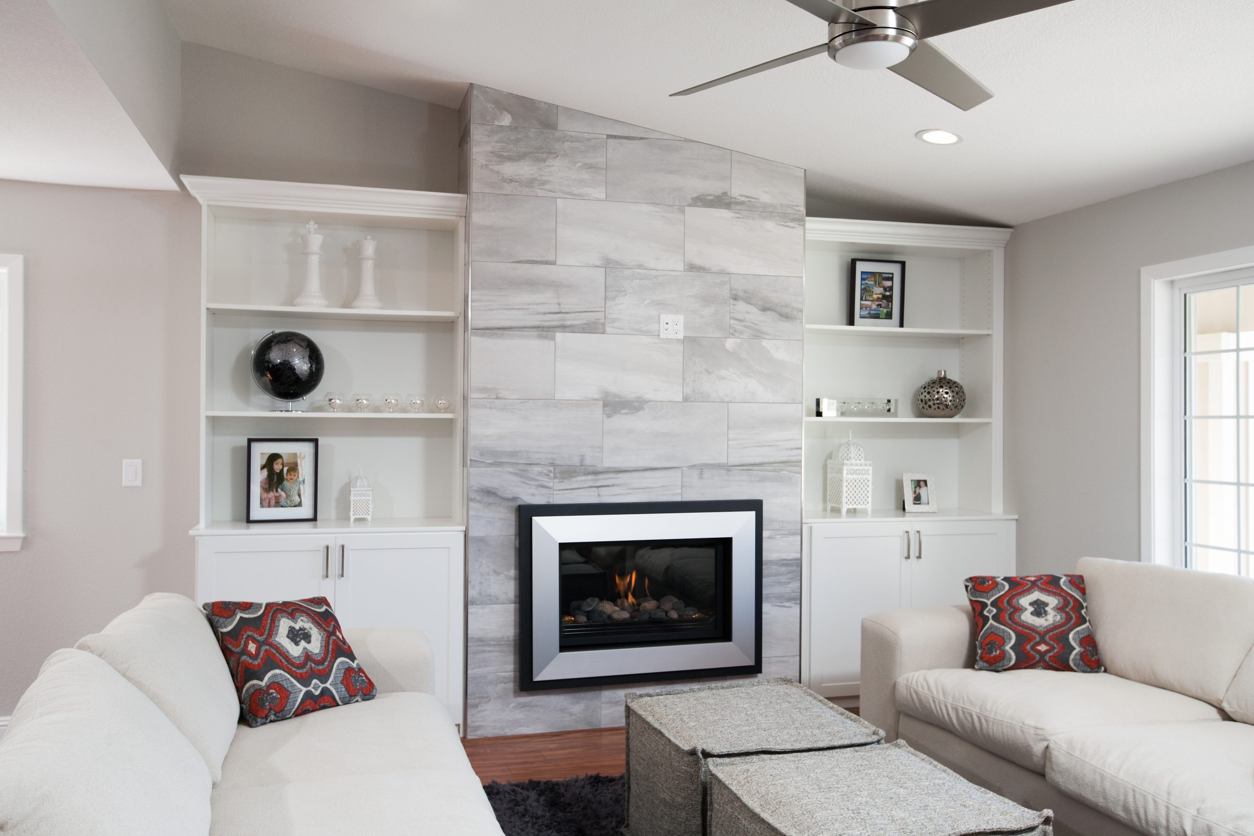A fireplace recessed into a living room wall.