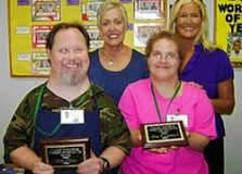 Workers of the Month James Keiper, left, and Nancy Nelson pose with Mary Wojciechowski of Valley Industries and Julie Berthold of Delmar Gardens North.