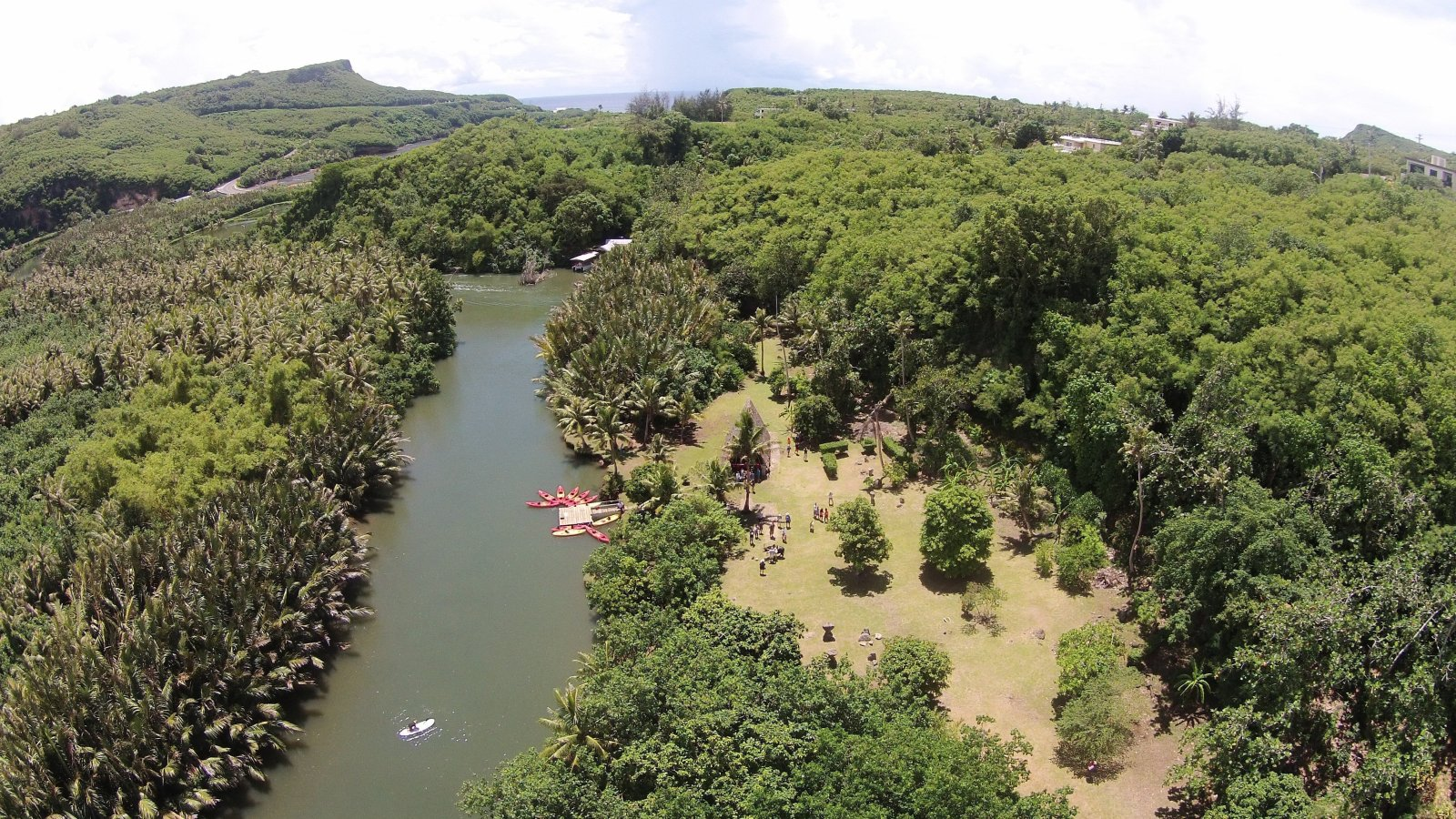 Valley of the Latte Adventure Park- Aerial photo of the Talofofo and Ugum Rivers, Kayakers, River Boats, Families, Locals, and Tourists enjoying the wonder of the Valley of the Latte.