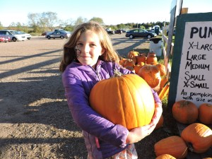 Girl with Large Pumpkin