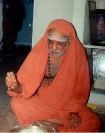 Swamigal giving thirtha prasadam
