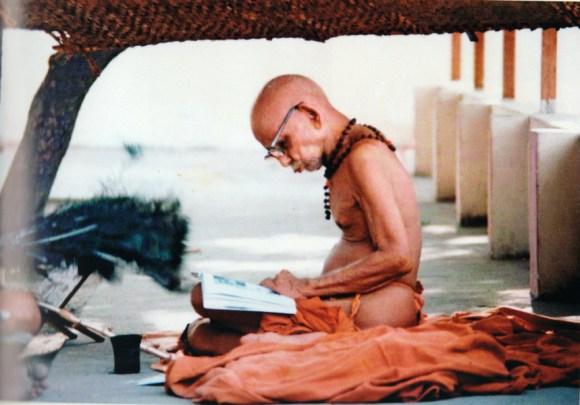 Mahaperiyava reading a book