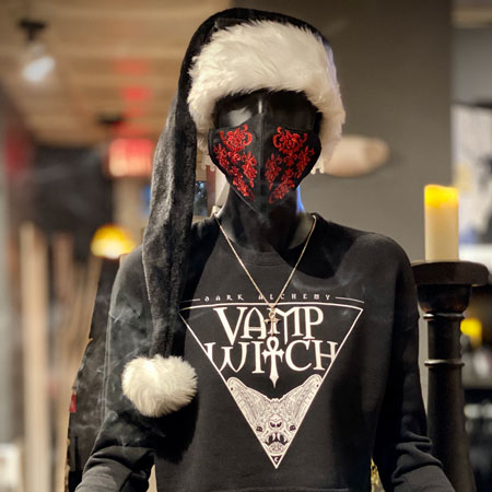 Vampfangs' store mannequin wearing a black santa hat along with a red brocade embroidered face mask and a Dark Alchemy crop crew in the Vamp Witch design.