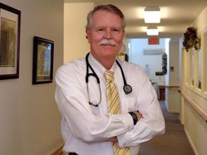 John E. Burke, MD