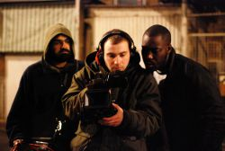 "Anarchist filmmaker Gregory Hall (centre) on the set for ""Bruised"" (2012)"