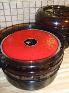 The liquid fruit puree is spread onto dehydrating trays