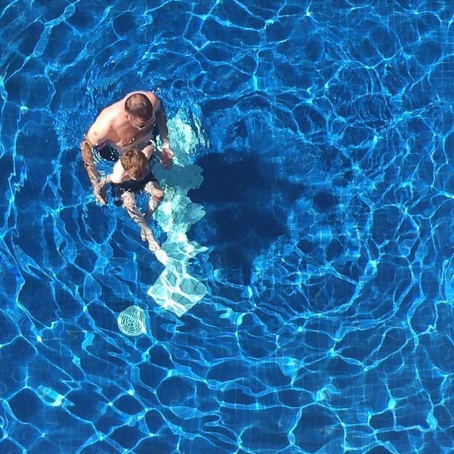 pool swim kids and dad