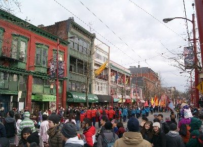 Vancouver's International Village with crowds of people watching a performance