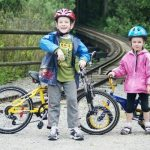 Young boy and girl with bicycles on trails at the zoo