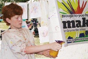 Boy Spray Painting at Kids Festival