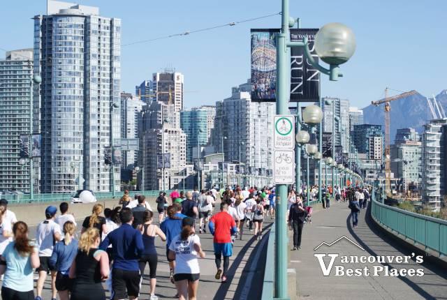 Runners on Cambie Street Bridge