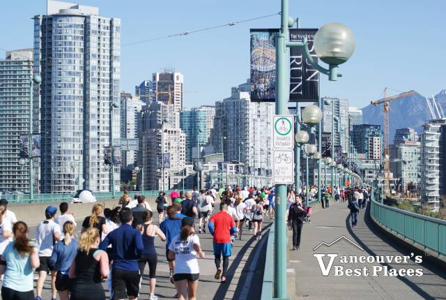 Runners on Cambie Street Bridge