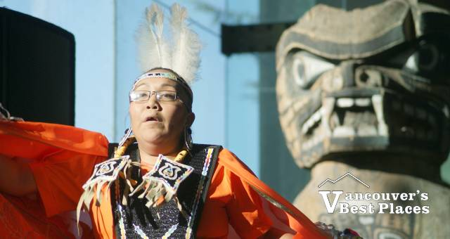 First Nation Dancer with Totem
