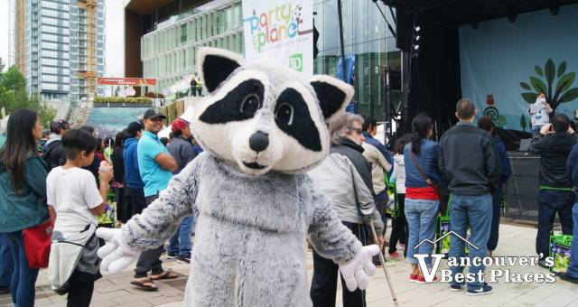 Party for the Planet Raccoon Mascot
