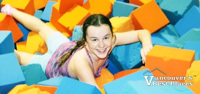 Girl in Sky Zone Foam Pit