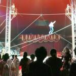 Circus Tightrope Walkers and Audience Silhouettes