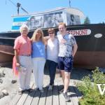 Posing in front of Beachcombers' Persephone Boat