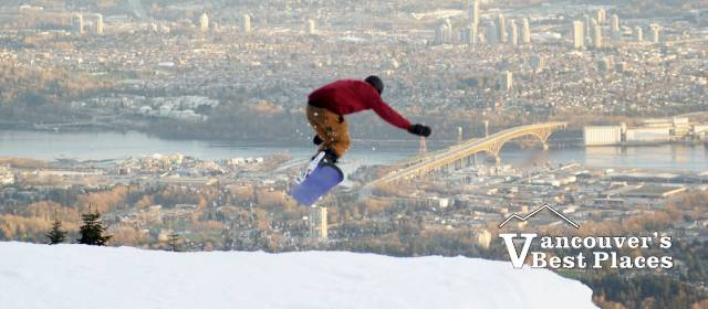 Snowboarder at Grouse Jam Over the City