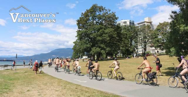 Naked Cyclists By English Bay Seawall