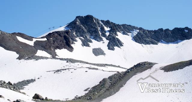 Whistler Ski Resort Peak to Peak gondola with snow covered mountain in the background