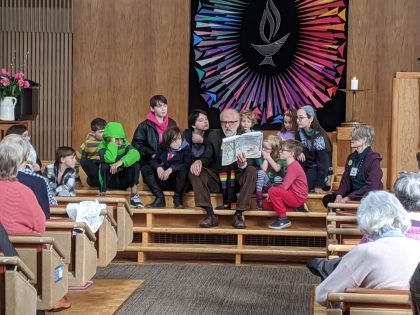 Rev. Epperson reading to kids