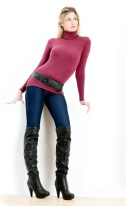 Standing woman wearing fashionable boots