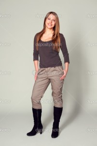 smiley woman in boots over dark background