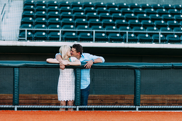 dugout-kiss-baseball-engagement-photos