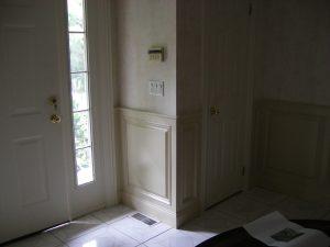 raised panel details around front door area