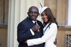 Mandatory Credit: Photo by REX/Shutterstock (6897943w) Edward Enninful after receiving his Officer of the Order of the British Empire (OBE) and Naomi Campbell Investitures at Buckingham Palace, London, UK - 27 Oct 2016