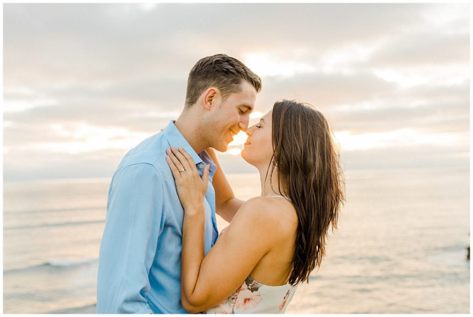 engaged couple at sunset cliffs in california
