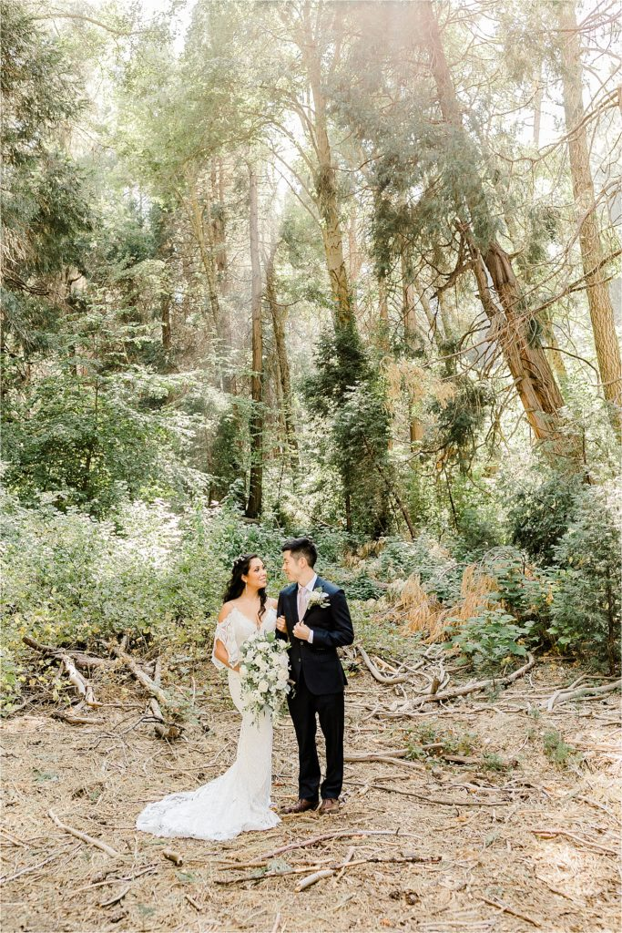 bride and groom getting married in forest