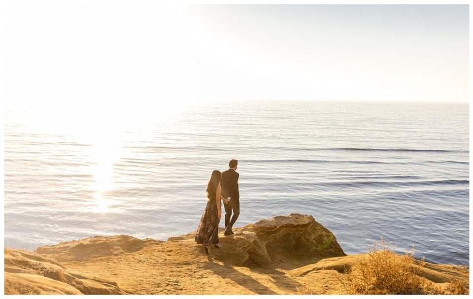couple walking on cliff at sunset cliffs